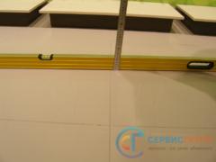 Проверка отклонения поверхности покрытия пола от плоскости